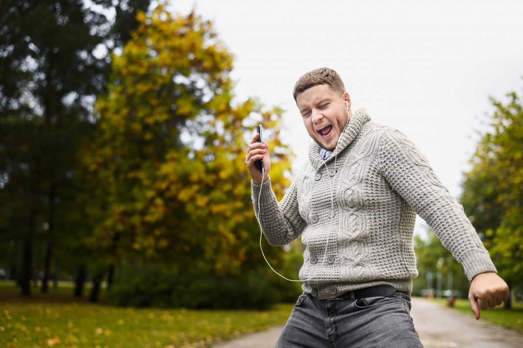 man walking in the park happy during fall